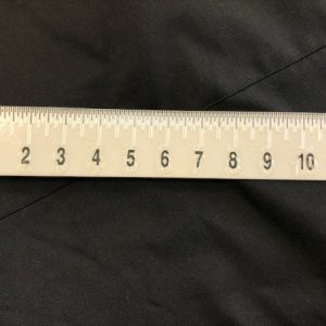white braille ruler black marking