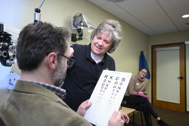Client working with low vision optometrist.